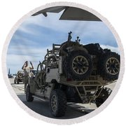 An All-terrain Vehicle Is Guided Onto Round Beach Towel