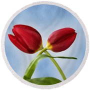 An Embrace Of Tulips Round Beach Towel