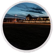 An Evening At The Train Station Round Beach Towel