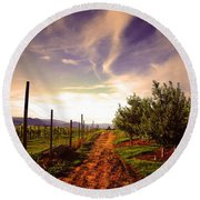 An Evening By The Orchard Round Beach Towel