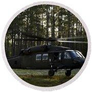 An Hh-60 Pave Hawk Evacuates Injured Round Beach Towel