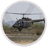 An Oh-58 Kiowa Helicopter Of The U.s Round Beach Towel