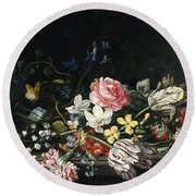 An Overturned Vase Of Flowers Resting On A Ledge Round Beach Towel