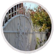 Angled Closeup Of White Washed Iron Gate To Garden Round Beach Towel
