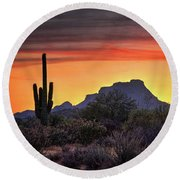 As The Sun Sets On Red Mountain  Round Beach Towel