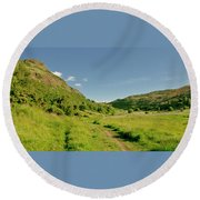 At The Base Of The Ancient Volcano. Round Beach Towel
