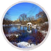 At The Frozen Lake Round Beach Towel