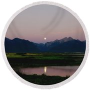 August Moon Over Mission Mountains And Ninepipes Refuge  Round Beach Towel