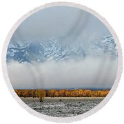 First Autumn Snow In The Mountains Round Beach Towel