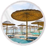 Beach Umbrellas And Chairs On Sandy Seashore Round Beach Towel