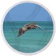 Beautiful Pelican Flying Over Aqua Waters In Aruba Round Beach Towel