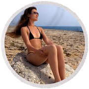 Beautiful Sexy Woman In Bikini Relaxing On A Rocky Seashore Round Beach Towel