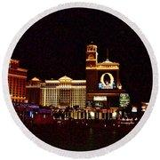Bellagio And Caesar's Palace In Las Vegas-nevada Round Beach Towel