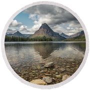 Between A Rock And A Beautiful Place Round Beach Towel