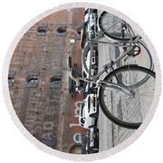 Bicycle And Building Round Beach Towel