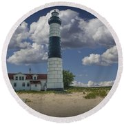 Big Sable Lighthouse Under Cloudy Blue Skies Round Beach Towel