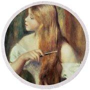 Blonde Girl Combing Her Hair Round Beach Towel by Pierre Auguste Renoir