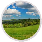 Blue Cloudy Sky Over Green Hills And Country Road Round Beach Towel