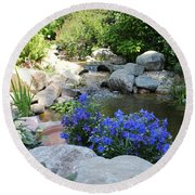 Blue Flowers And Stream Round Beach Towel