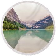 Blue-green Waters Of Lake Louise Round Beach Towel