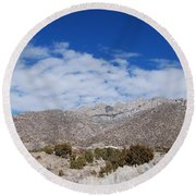 Blue Skys Over The Sandias Round Beach Towel