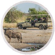 Blue Wildebeest Beside Puddle With Jeep Behind Round Beach Towel