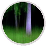 Blurred Trees Round Beach Towel
