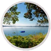 Boat Framed By Trees And Foliage Round Beach Towel