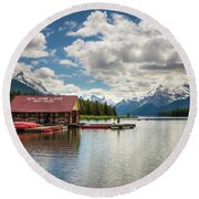 Boat House And Canoes On A Jetty At Maligne Lake In Canada Round Beach Towel