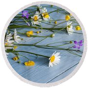 Bouquet Of Wild Flowers On A Wooden Round Beach Towel