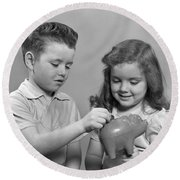 Boy And Girl Putting Money Into Piggy Round Beach Towel