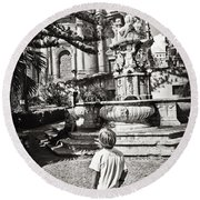 Boy At Statue In Sicily Round Beach Towel
