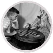 Boy Playing Checkers With Grandfather Round Beach Towel