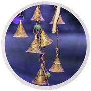 Brass Bells Hanging In The Illuminated Courtyard At Winter Night Round Beach Towel