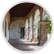 Brick And Stone Arches Line Walkway In Old Mission Ruin Round Beach Towel