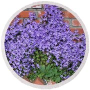 Brick Wall With Blue Flowers Round Beach Towel
