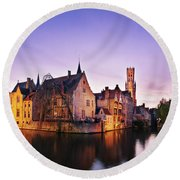 Bruges At Dusk Round Beach Towel by Barry O Carroll
