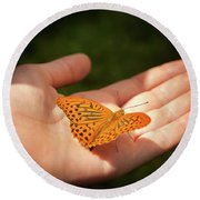 Butterfly On A Childs Hand Round Beach Towel