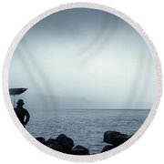 By The Sea In The Wind And Rain Round Beach Towel