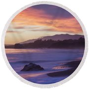Cambria Coastline With Purple Sunset Colors Round Beach Towel