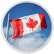 Canadian Flag Flying Proudly Round Beach Towel