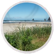 Cannon Beach And Purple Bloom Round Beach Towel