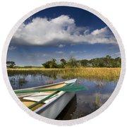 Canoeing In The Everglades Round Beach Towel by Debra and Dave Vanderlaan