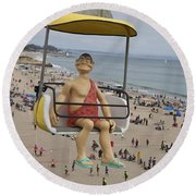 Caveman Above Beach Santa Cruz Boardwalk Round Beach Towel