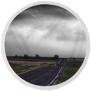 Chasing The Storm - Bw And Color Round Beach Towel
