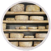 Cheese Wheels On Wooden Shelves In The Cheese Store Round Beach Towel