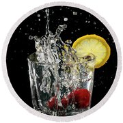 Cherries Splashing Into Sparkling Water Glass With Lemon Slice O Round Beach Towel