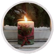 Christmas Candle Glowing On Window Sill With Snowy Evergreen Bra Round Beach Towel