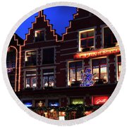Christmas Decorations On Buildings In Bruges City Round Beach Towel