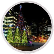 Christmas Tree On New Year's Eve In The Street Of A Big City Round Beach Towel